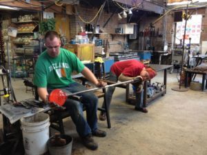 Eli and Margie blowing glass