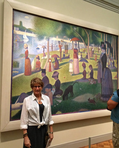 Cyndi in front of Seurat at Art Institute of Chicago