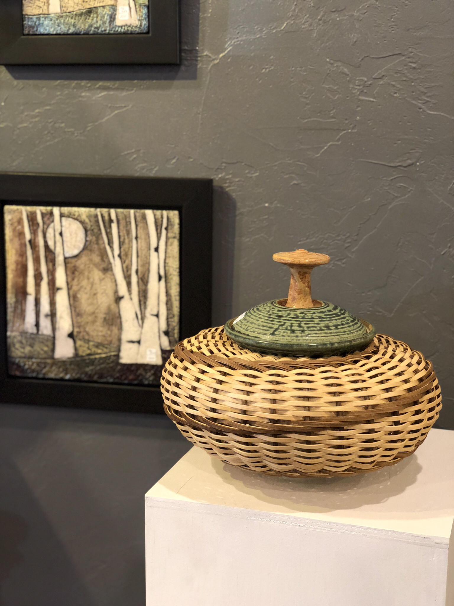 Raku wall hanging by Tonya Rund. Ceramic and Basket vessel by Stephen Kostyshyn