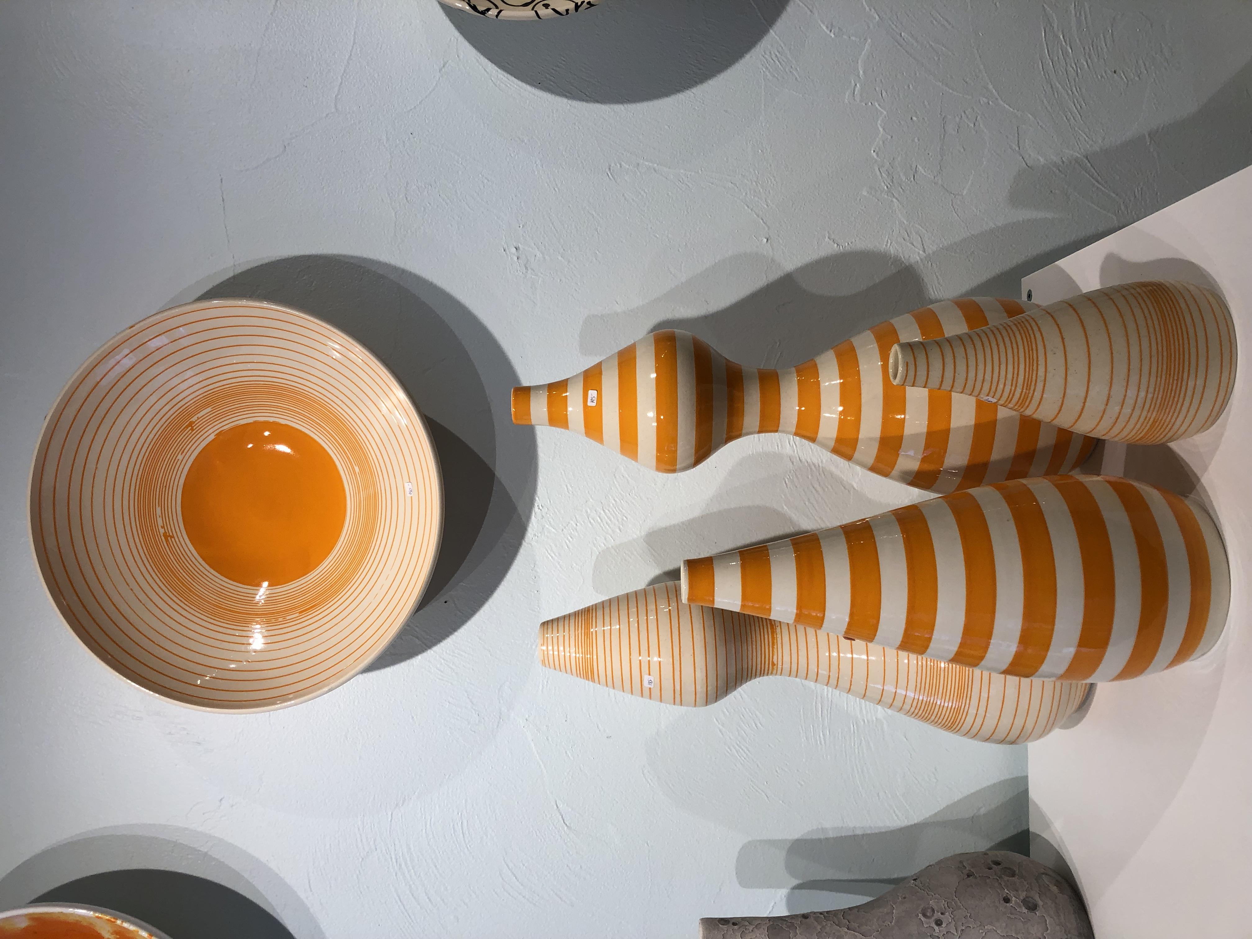 Orange ceramic vessels by Jeff Blandford